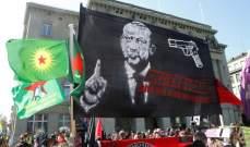 حزب العمال الكردستاني رفع صورة تحرض على قتل أردوغان أمام برلمان سويسرا