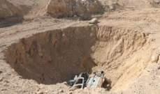 """التليغراف: الكشف عن أكبر مقبرة تضم قوافل ابادها """"داعش"""" على طريق الموصل"""
