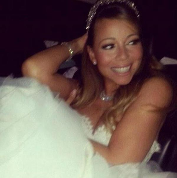 بالصور ماريا كارى بفستان زفاف