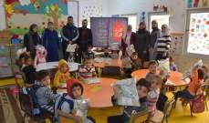 الرعاية توزع كنزة الشتاء على طلاب مدرسة عين الحلوة الإبتدائية الرسمية
