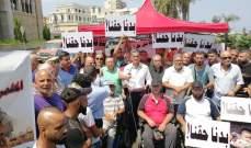 قطع طريق الميناء من قبل ذوي الاحتياجات الخاصة احتجاجا على إزالة أكشاكهم