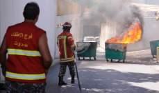 مياومو الكهرباء يحرقون مستوعبات النفايات في حرم المؤسسة