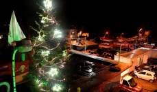 إضاءة شجرة الميلاد الخاصة بشهداء فوج إطفاء بيروت في الكرنتينا