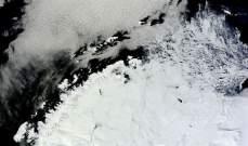 علماء يكتشفون حفرة عملاقة مغطاة بالجليد في القطب الشمالي