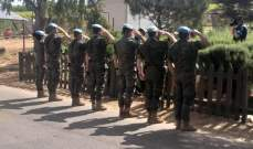 وفد من الكتيبة الإسبانية وضعوا إكليلا من الزهر على النصب التذكاري للجنود