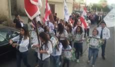 بلدية رأس بعلبك وكاريتاس نظمتا مسيرة دعما للجيش والمقاومة في البلدة