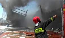 RT: قتلى وجرحى بحريق في منطقة شكوهية الصناعية بمدينة قم الإيرانية