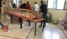 القومي والنهضة النسائيّة والرعاية الصحيّة يوزعون أغذية بالنبي عثمان