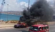 اخماد حريق في سيارة على الأوتوستراد الساحلي في الجية