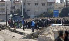 خروج 8 حافلات من حي الوعر في حمص تقل عدد من السكان بينهم 110 مسلح