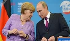 بوتين وميركل يؤكدان على ضرورة تكثيف الجهود الدبلوماسية لحل الأزمة الليبية