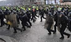 متظاهرون يشتبكون مع الشرطة الفرنسية في محيط الشانزيليزيه
