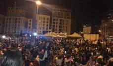 اعتصام نحو ألفي سيدة في ساحة الشهداء مع اضاءة شموع دعما للحراك الشعبي
