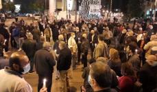 أصدقاء ومناصرو مسعود الأشقر تجمعوا بساحة ساسين لرفع الصلوات وإضاءة الشموع من أجل شفائه