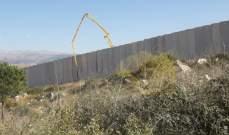 النشرة: ورشة اسرائيلية تعمل على اعادة تأهيل المساحة بين السياج الحدودي والجدار العازل في محيط مستعمرة المطلة