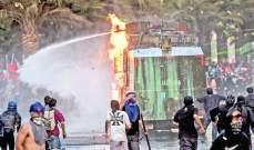 127 جريحا جراء أعمال عنف في تشيلي شملت سرقة مصرف وهجمات على مراكز للشرطة