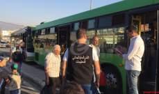 النشرة: دخول 15 حافلة عبر المكصنع لتأمين عودة 960 نازحا سوريا