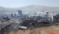 """""""التايمز"""": سوريون يفرون بعدما أضرم السكان النار في مخيم المنية للاجئين"""