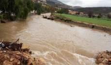 النشرة: فيضان نهر الزهراني نتيجة تدفق الأمطار في مجراه