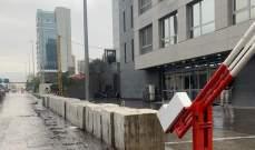 إزاحة السواتر الاسمنتية عن الطريق امام مبنى الأمن العام في العدلية