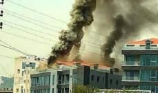 إخماد حريق على سطح مجمع تجاري في ساحل علما