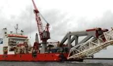 انقلاب سفينة كابلات في مضيق سنغافورة بعد اصطدامها بناقلة نفط