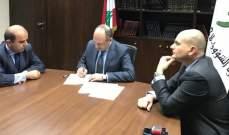 """بو عاصي يوقع مع """"DHL"""" اتفاقية حسم 50 بالمئة للجمعيات المتعاقدة مع الوزارة"""