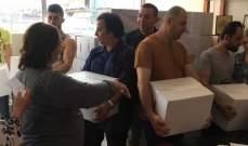 الرابطة السريانية توزع حصص غذائية لمئات من أبناء الطوائف المشرقية