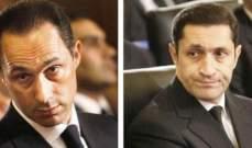 محكمة مصرية تقرر حبس نجلي مبارك مع سبعة متهمين آخرين بقضية فساد