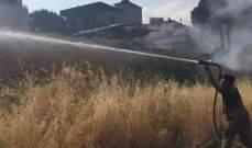 إخماد حريق اعشاب واشجار متنوعة في قب الياس-البقاع الاوسط
