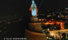 إضاءة مزار سيدة لبنان بحريصا بالعلم اللبناني تضامناً مع اللبنانيين بحربهم على الكورونا