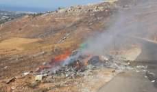 مجهول أفرغ شاحنة نفايات على مجرى نهر البارد وأضرم النيران فيها