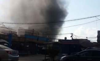 اندلاع حريق في أحد المحال في حي سكني محلة الأوزاعي