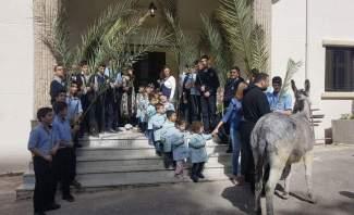 مدرسة مار شربل حاريصا احتفلت بأحد الشعانين في زياح سار فيه أطفال المدرسة