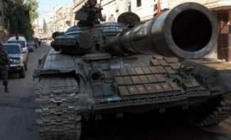 """مشاهد خاصة بـ""""النشرة"""" لسيارة محملة بالأسلحة والذخائر ضبطت في حمص"""