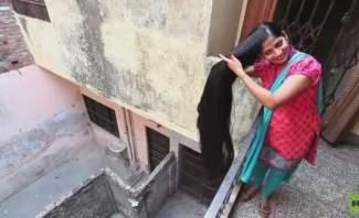 هندية تسعى لدخول غينيس بطول شعرها