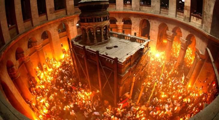 فيض النور المقدس من قبر السيد المسيح في كنيسة القيامة بالقدس