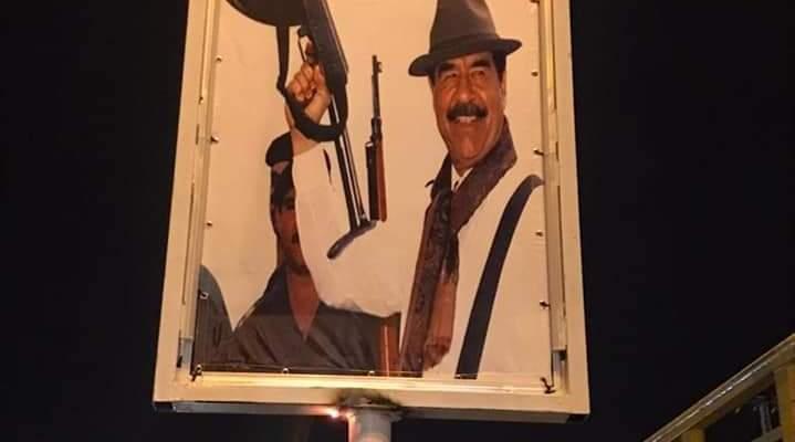ناشطون رفعوا صورة لصدام حسين على تقاطع تعلبايا