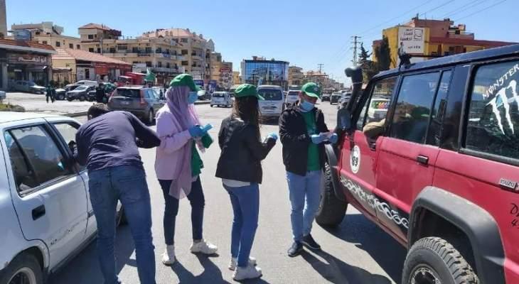 توزيع كمامات وحملة إرشادات وقائية لمكتب الشباب والرياضة في أمل في ذكرى يوم القسم