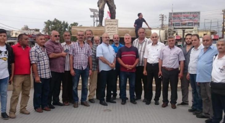 وقفة رمزية للعسكريين المتقاعدين امام النصب التذكاري للجيش في العبدة