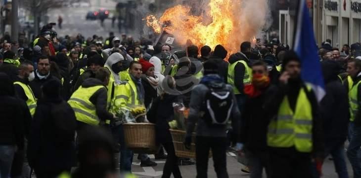 العربية: احتراق سيارات في وسط باريس بعد الاشتباكات بين الشرطة ومحتجين