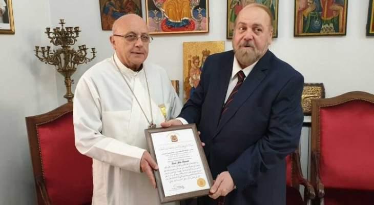 المطران درويش تلقى شهادة راعي حوار الأديان والحضارات العالمية من منظمة اويسكو