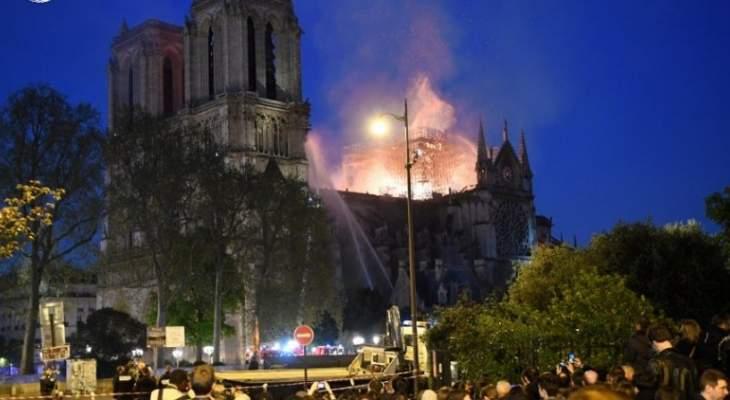 سي إن إن: إنقاذ البرجين الأساسيين لكاتدرائية نوتردام وإصابة رجل إطفاء إصابة بليغة