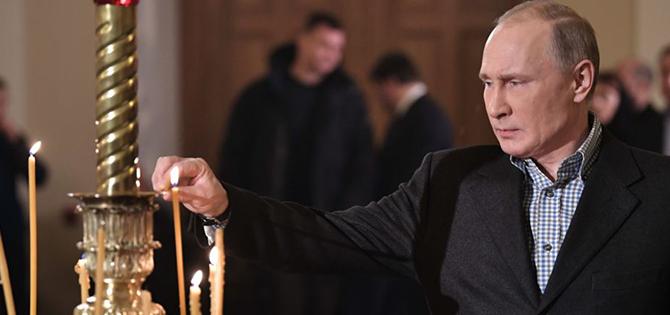 بوتين يحضر قداس عيد الميلاد في إحدى كنائس بطرسبورغ