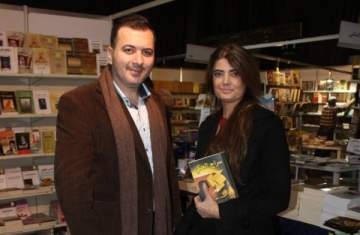محمد علوش يوقع كتاب