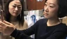 """""""آيفون X"""" يفشل فى معرفة الفرق بين سيدة صينية وزميلتها فى العمل"""