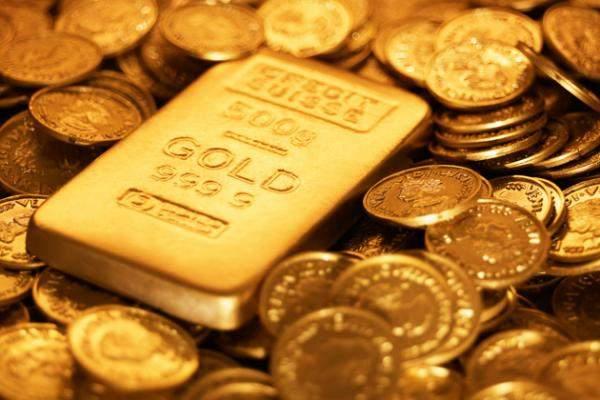 الذهب يغلق مستقراً عند 1327.10 دولار للأوقية