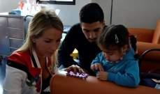 سواريز وزوجته يزوران مؤسسة لمرضى السرطان