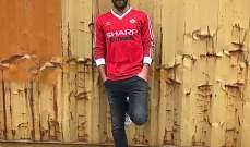 ماتا يرتدي قميص اليونايتد من عام 1982