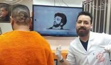 حلاق مصري يرسم وجه محمد صلاح على رؤوس عشاقه